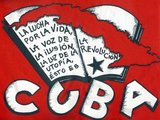 The Spanish text reads: 'La lucha por la vida, la voz de la ilusión, la luz de la revolución, la utopía es Cuba', or 'The struggle for life, the voice of the illusion, the light of the revolution, utopia is Cuba'.